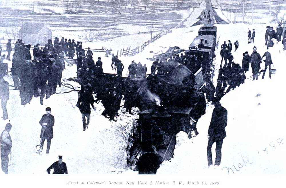 blizzard of 1888 As trains pass by on either side, a lone person walks across the brooklyn bridge  after the blizzard left the bridge and tracks covered in snow,.